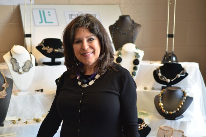 Melanie Ferrara standing near her jewelry display at McLean Community Center. Her website is www.jewelrylink.us.