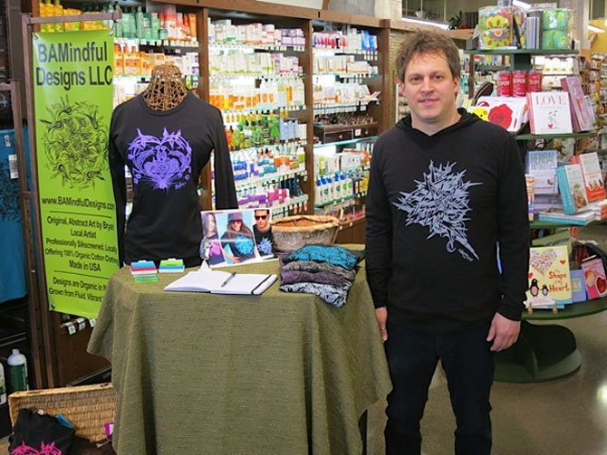 Bryan Morris of Potomac with his collection of t-shirts at Whole Foods Market in Rockville.