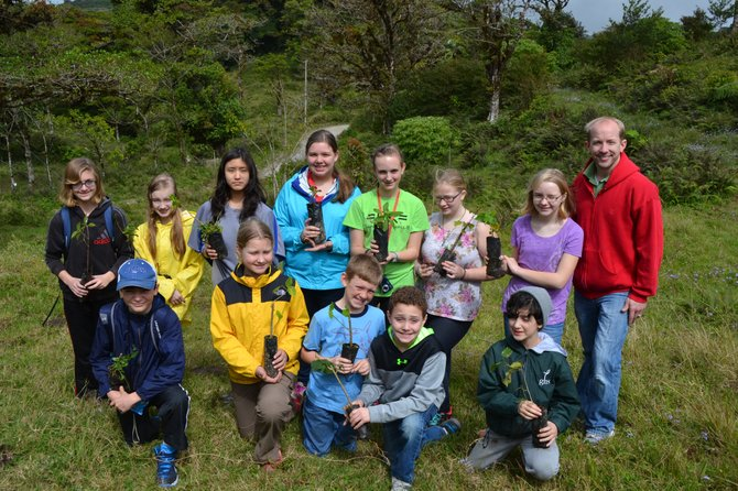 Students planting trees in Santa Elena Cloud Forest. Top from left- Caroline Simone, Greta Beggs, Susan Suh, Anna Grace Hopkins, Morgan Billingslea, Claire Bonadio, Kate Van Meter, CRES Principal Ken Junge. Bottom from left- Carter Lewis, Emma Frank, Alex Braswell, Rocco Bognet, and Kimiya Afsharnia