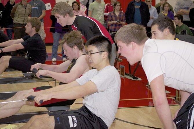 Augene Lee is cheered on by his Lake Braddock High classmate Kelton Hudson.