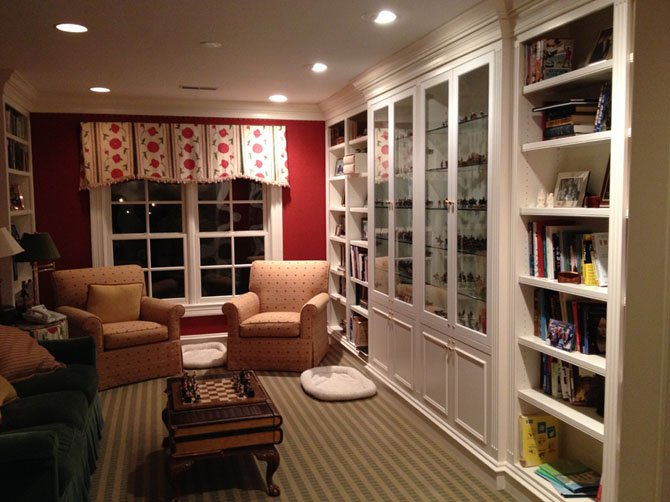 BOWA Builders, Inc. principal Steve Kirstein enclosed the top of a two-story foyer in his Potomac, Md., home to create a second-floor family gathering space. The room includes built-in book and display cases.