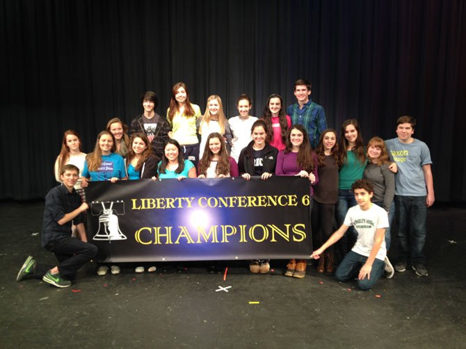 The Saxon Stage cast and crew poses with their Conference 6 championship banner.