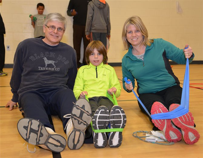 The Melnick family are ready to prove that this was, indeed, Family Fitness Night. Dad John teaches ESL at Lake Anne, son Evan attends in the fourth grade, and mom Lorrie Ann was keeping up her end of the fitness bargain.