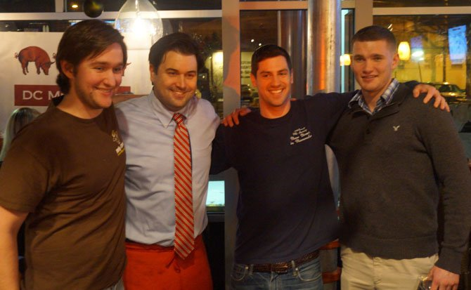 Pork Barrel BBQ co-owner Bill Blackburn, second from left, poses for a photo with High on the Hog Challenge contestants Lee Takett, Tim Mannel and Jake Barker.