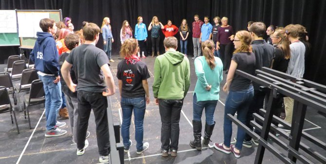Workshop instructor Judy Thibault Klevins leads the student in a circle exercise.