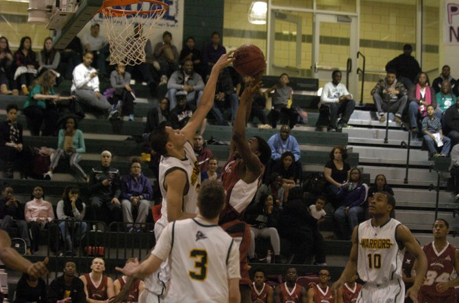 Wakefield junior Dominique Tham blocks a shot during the Warriors' 70-48 win over Mount Vernon on Feb. 15.