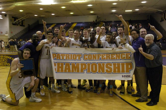 The Lake Braddock boys' basketball team beat Woodson to win the Conference 7 championship on Friday night.