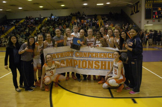 The West Springfield girls' basketball team beat T.C. Williams on Friday won the Conference 7 championship.