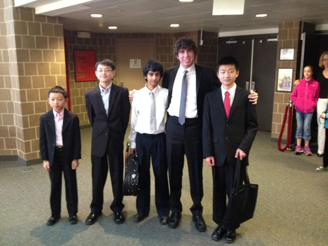 The musicians stand together in the Alden Theatre lobby following the performance. From left: Victor Pan, Evan Hu, Shankar Balasubramanian, Adam Heins, and Kevin Wang.
