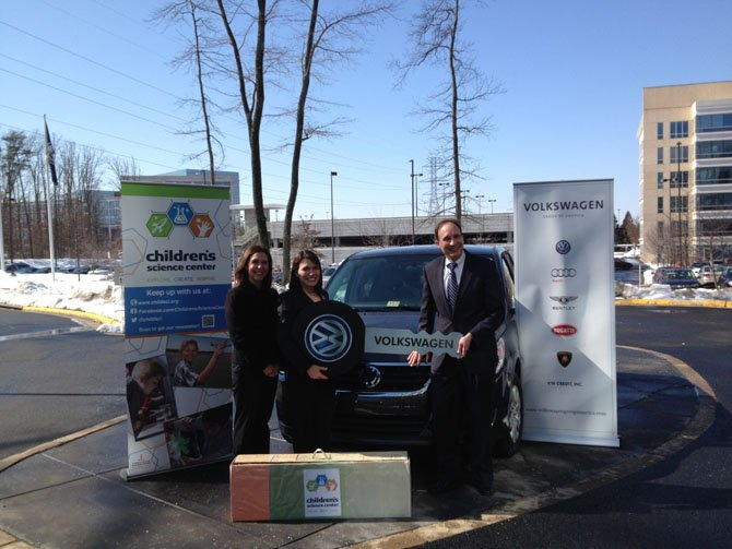 Chairman of the Board of Directors Tanya La Force (left) and Executive Director Nene Spivy accept Volkswagen's donation from Volkswagen Group of America Vice President of Finance Gerhard Kiewel (right).