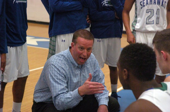 South Lakes boys' basketball coach Andrew Duggan talks to the Seahawks during their 6A North regional contest against West Potomac on Feb. 24.