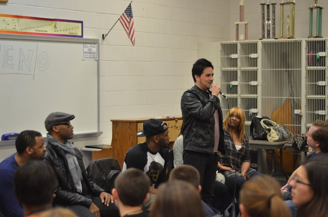 "John ""Jontez"" Montes, singer in the Dallas based vocal band TEN stands up to answer a question at South Lakes High School in Reston."
