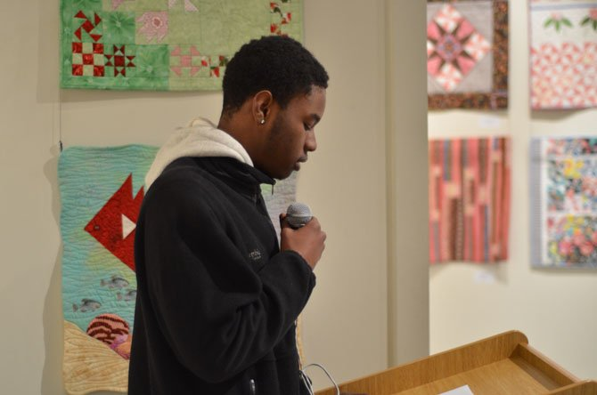 Malik Piersol, a Westfield High School senior, speaks at the ArtSpace Herndon on the history of African American cuisine at ArtSpace Herndon.