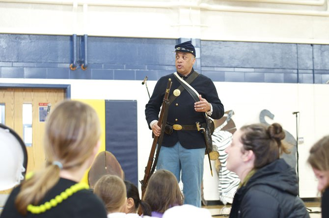 Kelly Washington from the 54th Mass Reenactment Troop instructs the crowd.