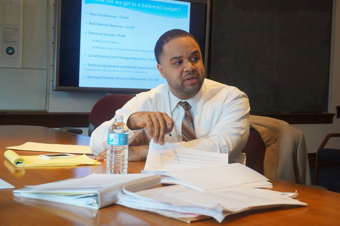 City Manager Rashad Young reviews the details of his proposed $634.8 budget for FY 2015 during a media briefing at City Hall Feb. 25.