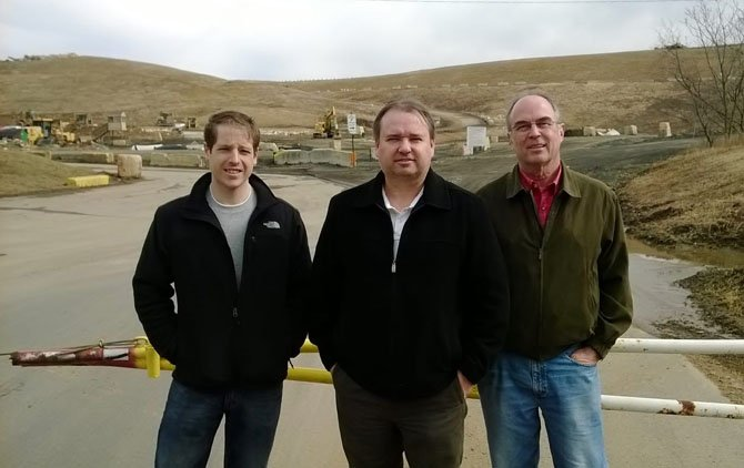 Martin Rizer, Nicholas Firth and Bill Lynch stand near the EnviroSolutions operated landfill in Lorton.