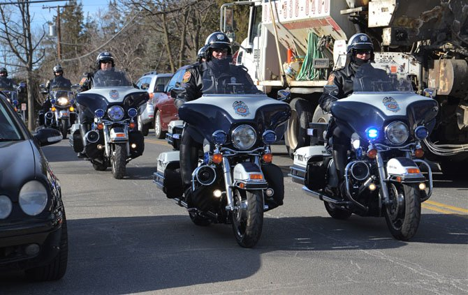 The Honor Guard – Motorcycle Police Officers clear the way as they escort the hearse carrying Vienna Mayor Jane Seeman from Vienna Presbyterian Church in Vienna to Oakton for burial at Flint Hill Cemetery.
