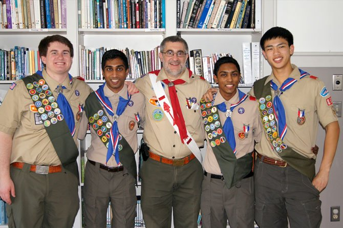 The ceremony recognized the achievement of the four boys in attaining the highest rank of Boy Scouting.