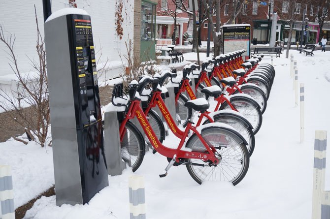 Bicycles sit idle during the storm.