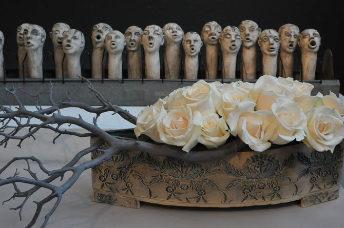 "Mary M. Corley worked with ""The Choir"" a porcelain piece and a clay centerpiece container both by Christine Hubloue."