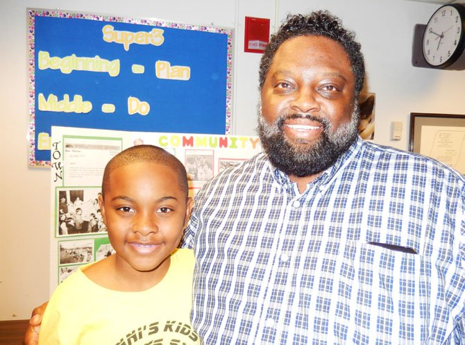 Fifth-grader Justin Williams and dad, Phillip Williams, who also attended Archer Elementary.