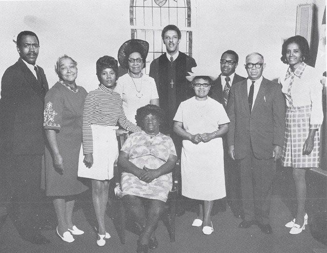 Deloris Evans, pictured on the right, founded the Esther Honesty Scholarship Committee in 1963. The scholarship awarded college funds to young members of Shiloh Baptist Church in McLean. The Scholarship Committee still exists today. The late Pastor Roger V. Bush is pictured in the center back.