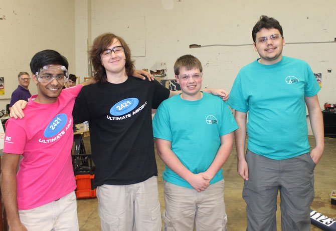 Ragav Goyal, David Kitrinos, Andrew Peace, and Ryan Beaver, co-captains of RTR Team Robotics and AIM Robotics, pose together at their practice space in Lorton.