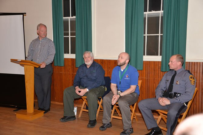 Great Falls Citizens Association Vice President Bill Canis runs the Town Hall Meeting. His panel of expert speakers on topics related to deer management were Jim McGlone with the Virginia Dept. of Forestry, Josh Smith with Fairfax County Dept. of Health, and Virginia State Trooper Hendrick.