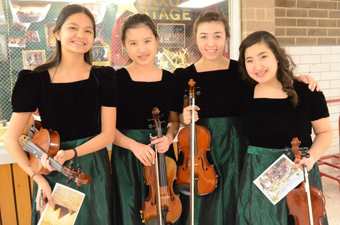 Langley HS Orchestra freshmen students pose for the camera after a fantastic performance in the Pyramid Pride Concert. From left: Violist Katherine Quion, violinists Su Yeon Yoo, Jackie Fraley, and Sadaf Sizdahkhani.