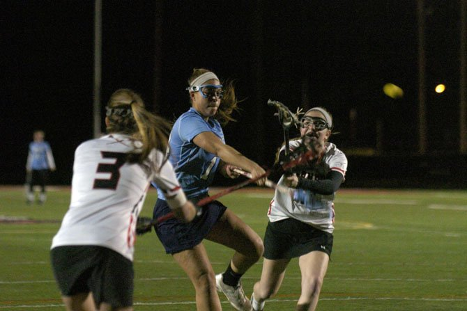 Yorktown junior Kristen Somers shoots during a scrimmage at Herndon High School on March 14.