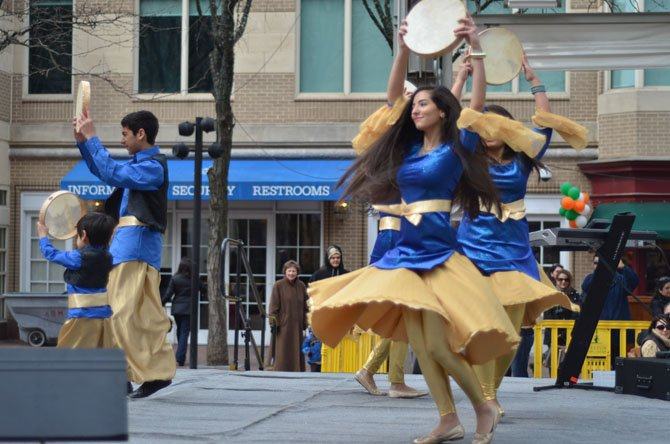 Members of Cyrus Academy in Sterling perform a dance at the 2014 Nowruz celebration at Reston Town Center. To the left are Koroush Bana and his younger brother Kiarash Bana.