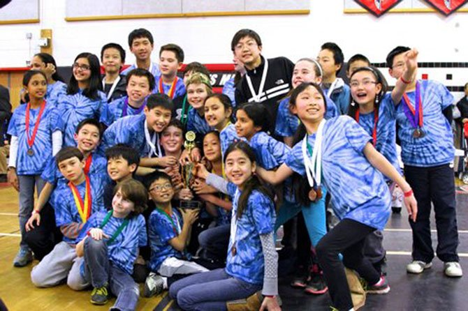 Churchill Road Science Olympiad team members, from left: Rupa Siva, Mrs. Rajee Ramesh (obscured), Brian Wang, Daniel Wen, Brandon Torng, Ethan Schoenberg, Dylan Tschampel (obscured), Ms. Jen Ezzell (obscured), Samuel Kim, Anna Krause-Steinrauf, Ethan Li, Alex Zhang (obscured), Cynthia Wang and William Wang.  Clockwise from center around trophy:  Ethan hsaio, Daniel Kalish, Eric Kim, Nolan Ward, Ryker Bendewald, Victor Bo, Ian Palk,  Katie Jeong, Austin Young, Ladan Haiderbaigi, Sahana Ramesh, Ashley Xing, and Yujin Kim.