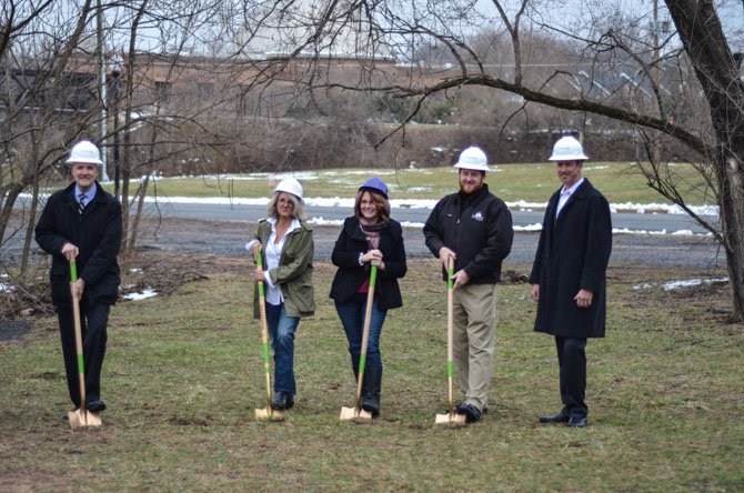 Jim Cornwell, Beth Clifford, Herndon Mayor Lisa Merkel, Rob Cappellini, and Warren Ralston pose for a photo during the groundbreaking ceremony for the new Vinehaven homes development.