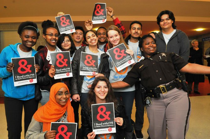 Members of the T.C. Williams Influence Club pose for a photo with Deputy Sheriff Valarie Wright.