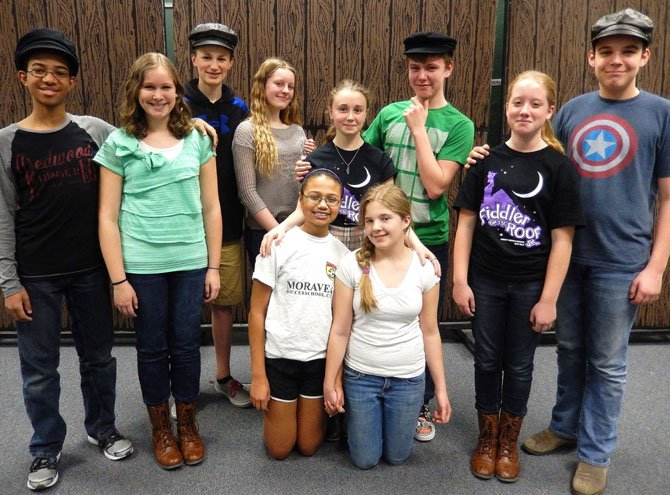 The lead actors include (standing, from left) Caton Gayle, Brooklynn Pendleton, Paul Anderson, Laura Cantagallo, Margot Vanyan, Jared Renaud, Jensyn Volpe and Maxwell Leitch; and (kneeling, from left) Mya Baptiste and Savannah Gregory.
