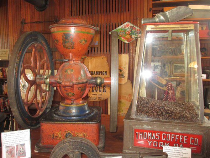 Turning the grinding wheel of this turn-of-the-19th-century coffee grinder ground the beans from the top container.