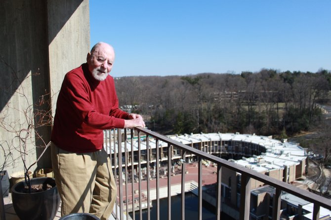 Robert Simon overlooks Washington Plaza at Lake Anne, where Reston's opening ceremony was held in 1965.