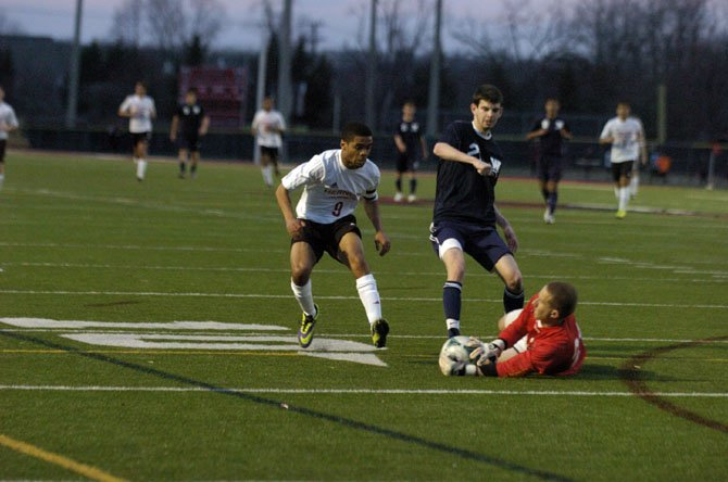 Herndon senior Brian Maye, left, scored two goals during the Hornets' 3-1 victory over Woodson on March 28.