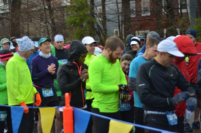 Participants in the Reston Runners March half marathon make final preparations at the starting line. At the end of the day, new course records were made.