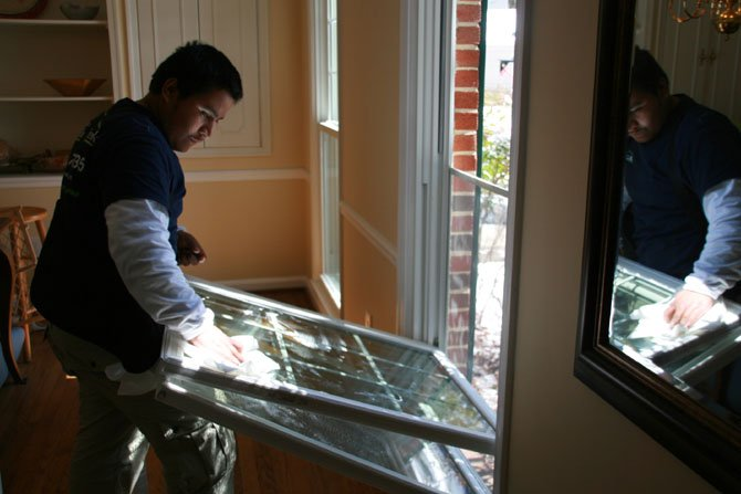 Immanuel Bible Church in Springfield coordinated the effort to finish repairs on Martin Bodrog's house. Here, an employee of Thompson Creek installs a window, part of the $30,000 donation made to the Bodrog house.