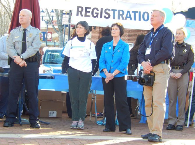 From left: Police Chief Ed Roessler Jr., Anne Haynes (Ron Kirby's widow), Board of Supervisors Chairman Sharon Bulova, police photographer Keith Dobuler and county Sheriff Stacey Kincaid listen to the speakers.