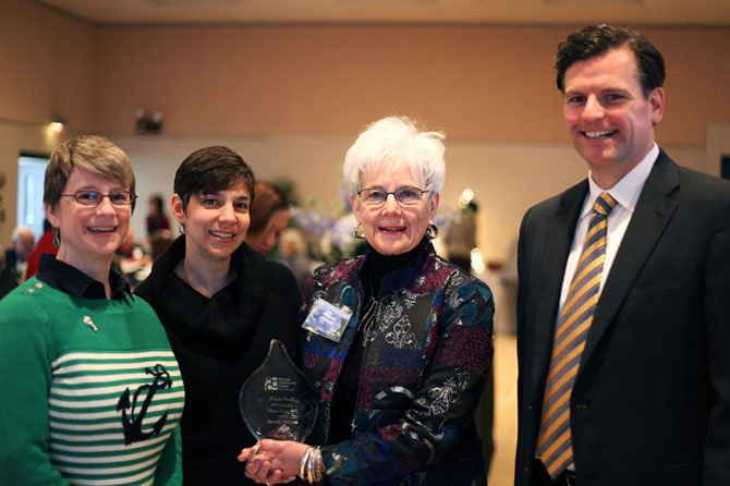 2013 Volunteer Award winner Beverly Howard, with MCC Governing Board Chair Chad Quinn, and her daughters (left to right) Laurie Felton and Karen Sasaki.
