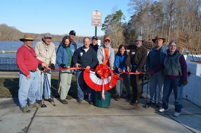 Friends of Lake Accotink Park Staff and volunteers at the ribbon cutting ceremony, Saturday April 5, for the newly installed donation box at the Park's Marina.
