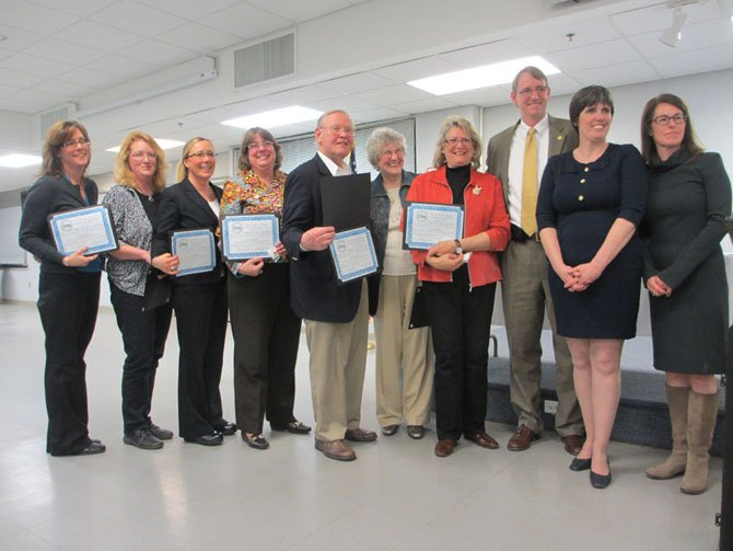 The 2014 Mayor M. Jane Seeman Award was presented to the 2013 Vienna Business Association Board of Directors. [From left] Peggy James, Mary Kay Klaus, Tracy Murphy, Kathy Georgen, George Creed, DH Scarborough, Carole Wolfand, and James Cudney, with Town Council members Carey Sienicki and Laurie DiRocco.