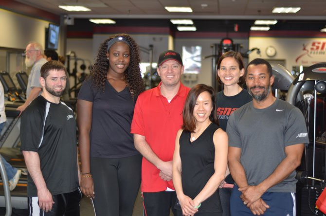 Snap Fitness staff Sean Boyd, Assiatou Kama, Sean Boyd, Jackie Le, Andrea Wallenhorst, and David Jordan at the Snap Fitness at Herndon Kmart Shopping Center on Elden Street.