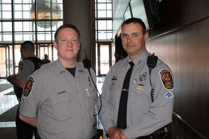 School Resource Officer Rich Barron and Mike Scanlon, president of the Fairfax Fraternal Order of Police, were among the hundreds of police officers who attended the public hearings on the Fairfax County budget at the Government Center on April 10.