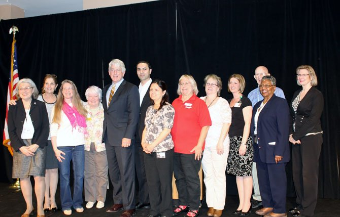 A group of vendors, Greenspring residents and Virginia Attorney General Mark Herring gather at the Fraud Prevention Expo in Springfield.