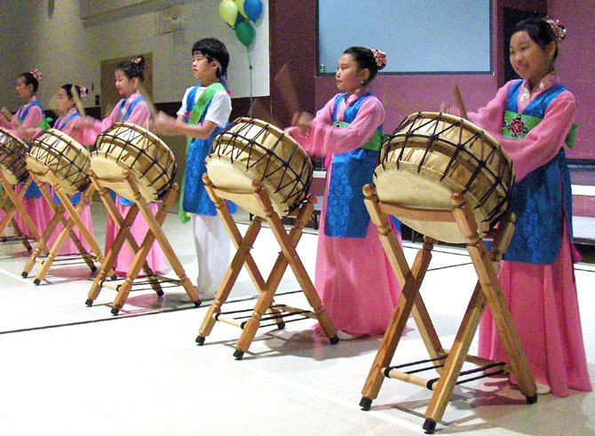 These Korean children did precision drumming during last year's celebration.