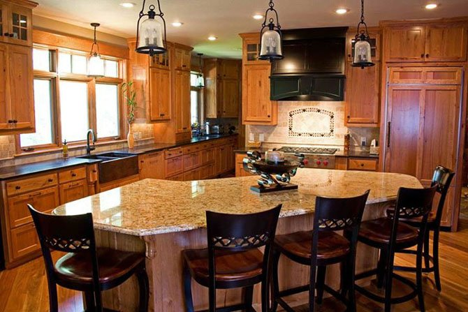 This kitchen, designed by Two Poor Teachers, includes a large entertainment island. Realtors say attractive kitchens help homes sell quickly.