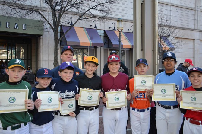 Reston Little League Leader's Scholarship Awardees pictured left to right: Jack Thompson, Nick Gryski, Josh Meade, Shea Huntington, Aiden O'Donovan, Braden Huebsch, Vikrant Magadi, and Sully Gholson with Sean Dooley of The Wise Investor Group in Reston.